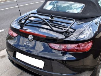 Alfa Romeo 939 Brera spider in gleaming black with a luggage rack fitted