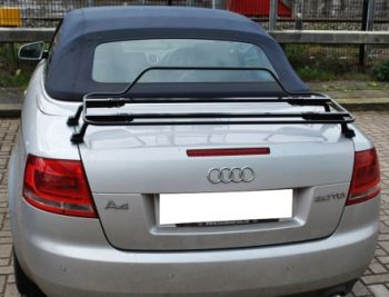 silver audi a4 convertible 2.0tdi with a black boot rack fitted