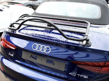 bright blue audi a5 cabriolet with a black luggage rack fitted to the boot photographed from the rear
