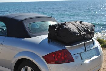 silver audi tt roadster typ 8n mk1 with a boot-bag vacation luggage rack alternative fitted parked next to the sea