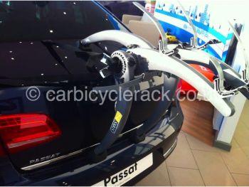 Dark Blue VW Passat with Bike Rack fitted in VW showroom