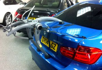 Blue BMW 5 series saloon with Bike Rack fitted in BMW showroom