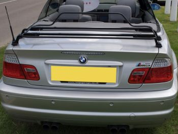 silver bmw e46 3 series convertible with a black luggage rack fitted