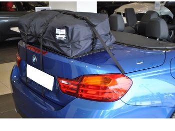 blue bmw 4 series cabrio with a bootbag vacation luggage rack fitted