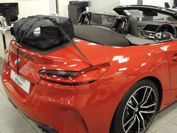 Red bmw z4 G29 20i with a boot-bag original luggage rack fitted