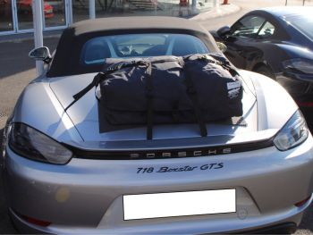 silver porsche boxster 718 gts with a bootbag luggage rack fitted