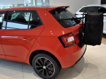 Red skoda fabia in a skoda showroom with a hatchbag roof box alternative fitted
