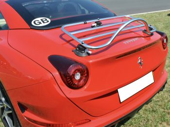 Red ferrari California with a stainless steel luggage rack fitted