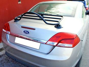 silver ford focus convertible cabriolet with a black luggage rack fitted
