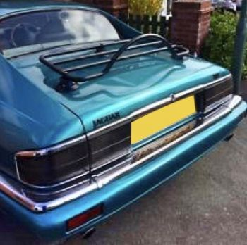 Blue jaguar xjs with a luggage rack fitted