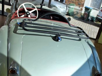Light green Jaguar XK120 in a showroom with a revo-rack black luggage rack fitted
