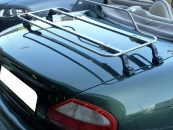Green Jaguar xk8 with a stainless steel luggage rack fitted