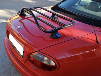 red jaguar xk8 convertible with a revo rack luggage rack fitted photographed from the side