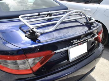 dark blue maserati gran cabrio convertible with a revo rack luggage rack fitted to the trunk