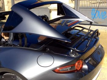 mazda mx5 rf luggage rack fitted to grey RF roof being lowered with the rack in place