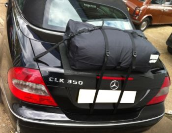black mercedes benz clk convertible with a bootbag original luggage rack fitted
