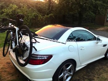 blue mercedes slk with a bike rack fitted photographed from above
