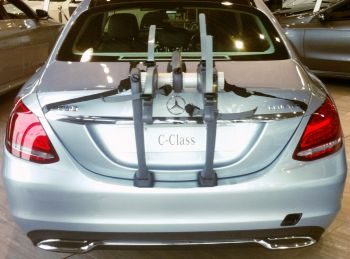 Rear view of Mercedes Benz C Class saloon with bike rack fitted in showroom