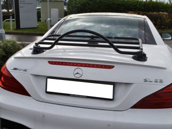 black luggage rack fitted to a white mercedes sl r231 sl63 amg