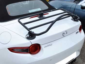 silver mazda mx5 mk2 with a boot rack fitted