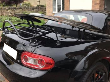 white mazda mx5 cc roadster coupe with a black revo-rack luggage rack fitted