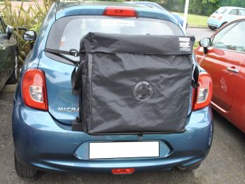 nissan micra roof box alternative hatch-bag fitted to a light blue nissan micra