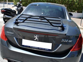 dark grey peugeot 308cc with a boot rack fitted