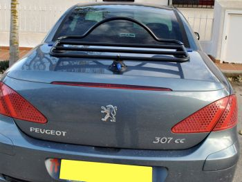 dark grey peugeot 307 CC with a revo-rack boot rack fitted
