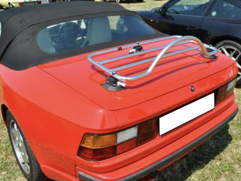 Red 968 cabriolet porsche with a stainless steel luggage rack fitted