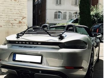 rear view of a silver porsche boxster 718 with a revo-rack luggage rack fitted