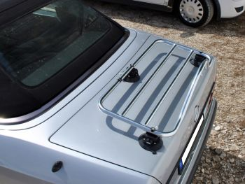 Silver W124 mercedes benz e class convertible with a revo-rack pa boot rack fitted on a sunny day