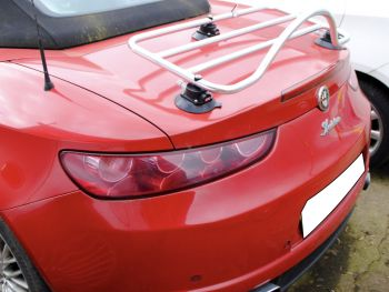 Red alfa romeo brera spider 939 with a stainless steel luggage rack fitted