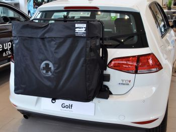 roof box for vw golf hatchbag fitted to a white vw golf in a volkswagen dealership