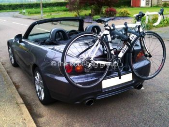 grey honda s2000 with a bike rack fitted