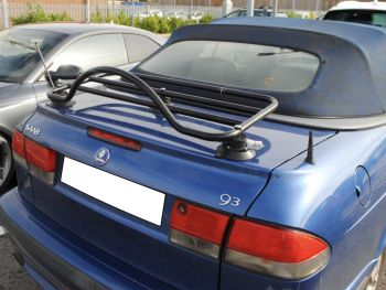 blue saab 93 cabriolet with a black luggage rack fitted in a car park on a sunny day