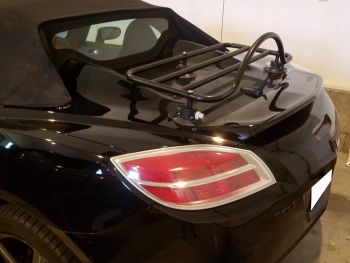 Black saturn sky with a revo-rack black luggage rack fitted to the trunk