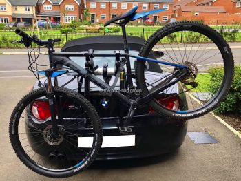 black bmw z4 e85 with a bike rack fitted carrying a mountain bike